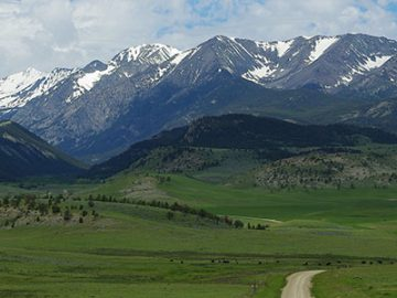 Montana mountains with a a trail leading up to it